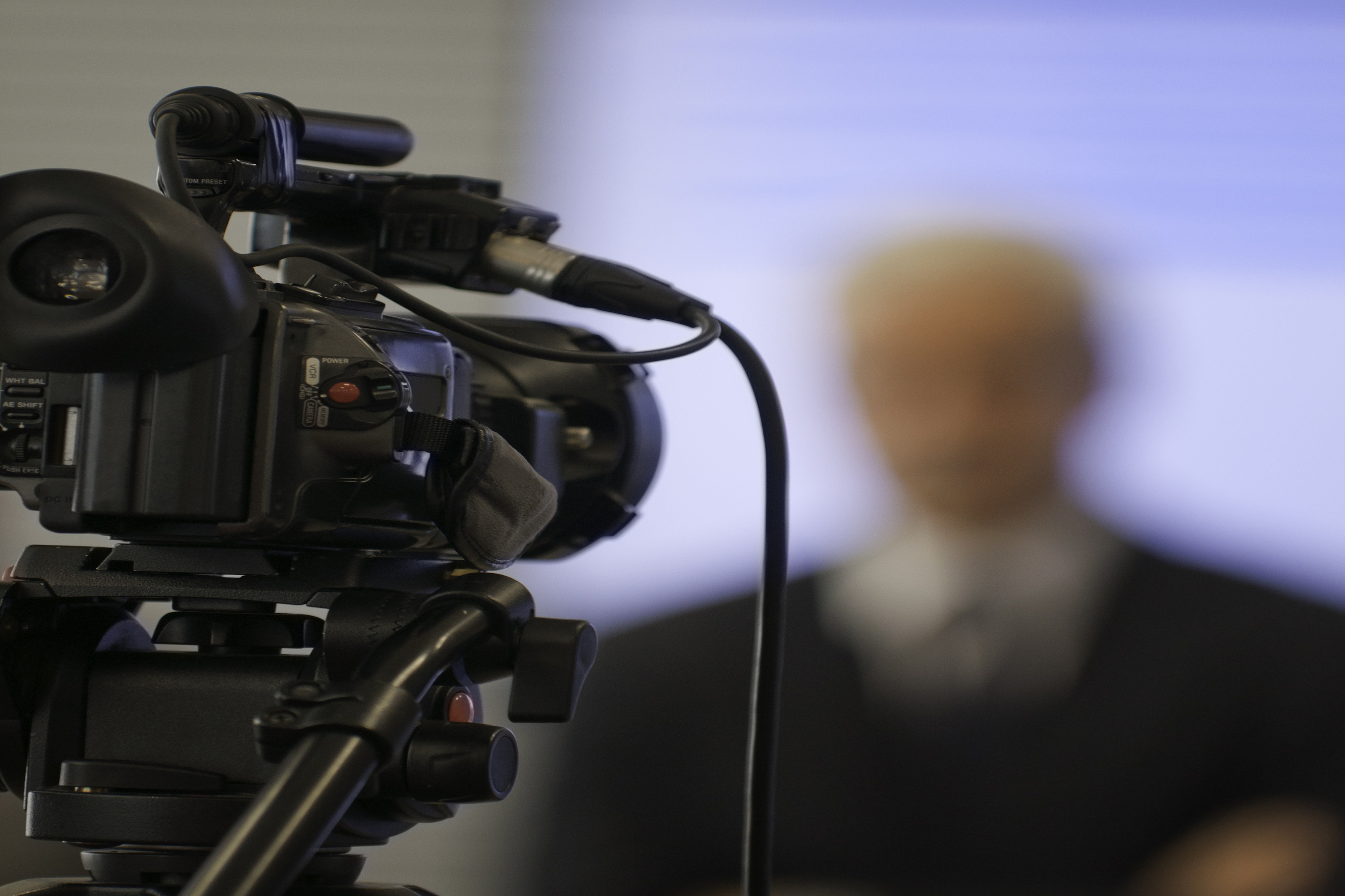 """Media coverage of a corporate presentation. Camera in focus, spokesman blurredUniform your project with related images:"""